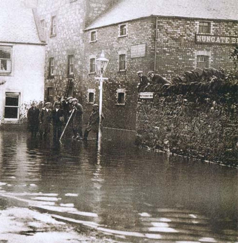 The Nungate Brewery looking down Whittinghame Drive, after the Tyne broke its banks, with the brewery sign clearly visible at the top right.