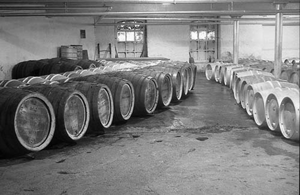 The cask beer cellar in the Thistle Brewery in the 1960s (black-out paint still visible on the windows!). © John Hume, 2015