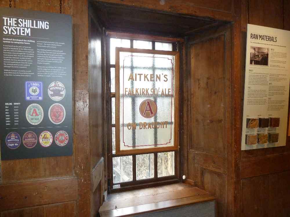 A pub window advertising Aitken's of Falkirk